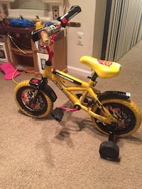 toddler's yellow and black bicycle with training wheels Falls Church, 22042