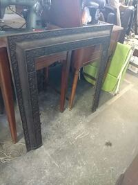 old cast iron fire place front Mantle