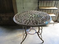round black metal framed glass top patio table LAWRENCEVILLE