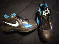 pair of black-and-blue Nike KD basketball shoes
