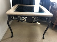 Coffee table and end table, if sold as set $180. Will sell items separately price negotiable. Glass , natural stone, and beautiful iron scroll work on skirt an legs.  Oxnard, 93036