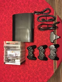 Black sony ps3 slim with Controllers/14 GAMES!!! 808 mi