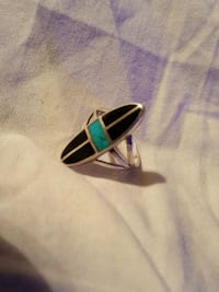 silver-colored ring with blue and black gemstones Yuma