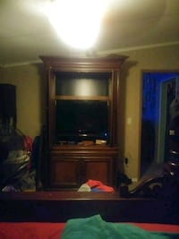 A big wooden TV Hutch holds up to a 42in TV  Chickamauga, 30707