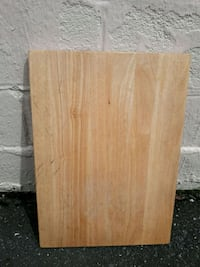 Wooden board with stoppers