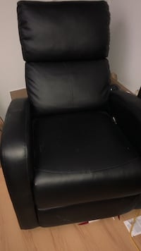 Black leather padded sofa chair