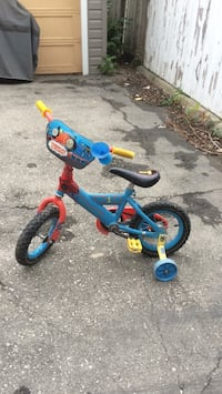 Toddler's blue and red bicycle with training wheels Winnipeg, R2Y 0T7