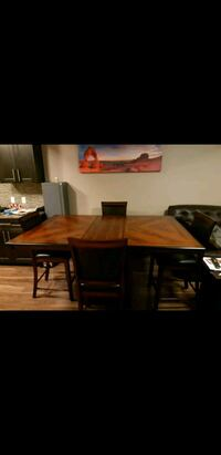 rectangular brown wooden table with four chairs di 3149 km