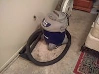 white and blue wet and dry vacuum cleaner
