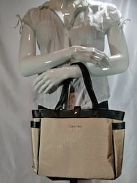 beige and black Calvin Klein tote bag
