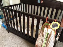 Brown color convertible crib with few scratches with free bin