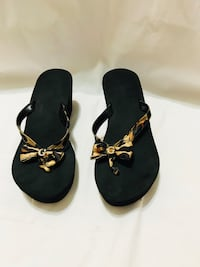 pair of black leather sandals New York, 10463