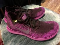 pair of pink-and-black Nike running shoes Calgary, T2V