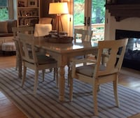 7 piece dining table set. Includes 2 armchairs and 4 chairs (cream). Includes 6 taupe chair cushions (all purchased in Pottery Barn). 60Lx36W (5ftx3ft) Orinda, 94563
