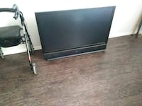black flat screen TV with remote Denton