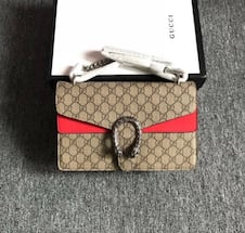 brown and a streak of pink gucci purse brand new.