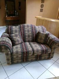 brown and red floral loveseat El Paso, 79915