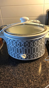 Blue and white crock-pot slow cooker