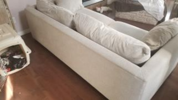 Well taken care of grey canvas sofa. Pirced to move