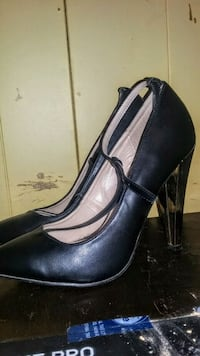 pair of black leather heeled shoes Regina, S4T 2N2
