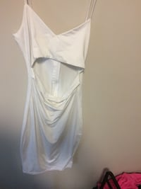 White cut out dress never worn size small also have it available in black Winnipeg, R2K 0B3