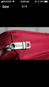 Authentic tumi travel pouch
