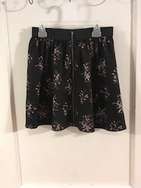 Black, pink, and white floral frontzip skirt. Size medium Gainesville, 32601