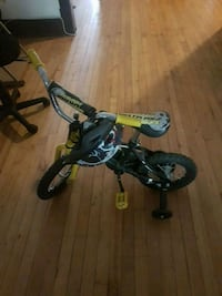 toddler's green and black bicycle with training wheels Winnipeg, R3M 0B4