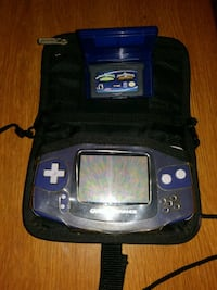 blue and black Nintendo 64 with game cartridge 43 km