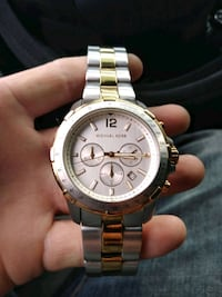 round silver-colored chronograph watch with link bracelet 731 mi