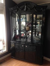 Black wooden framed glass display cabinet, high quality with a light in the top part. Excellent condition