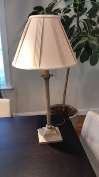 brown and white table lamp 150 km