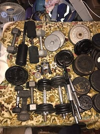 Assorted barbells and weights
