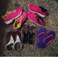 two pairs of pink sneakers