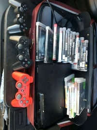 black and red Sony PS3 console with controllers and game New Westminster, V3M 3X7