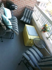 Beautiful outdoor rocking patio set. Made or iron and weather proofed.