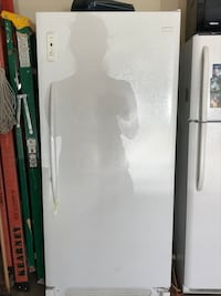 Frigidaire Freezer, measures 58x27. Freezer has 4 shelves and a pull out drawer. Door has multiple shelves- this freezer is in perfect condition and COLD!  No damages, perfect condition! Tempe, 85284