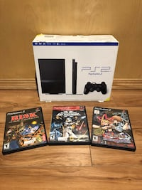 black Sony PS3 Slim with controllers and game cases Lloydminster (Part), S9V 1E7