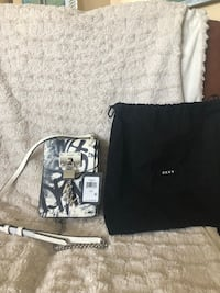 DKNY Leather Cross Body Purse. Sells for $148, tags still attached. Brand new! Temecula, 92592