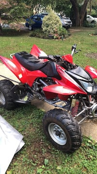 Red and black honda atv Dumfries, 22025