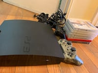 black Sony PS3 slim console with controller Silver Spring, 20902