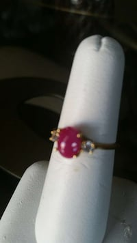 Cabachom Brazilian Ruby with 2 small ???? on each side.