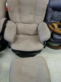 beige fabric armchair with square ottoman