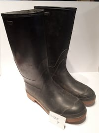 pair of size 7 black knee-high wellington boots