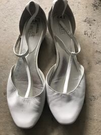 pair of white leather pointed-toe heeled shoes Surrey