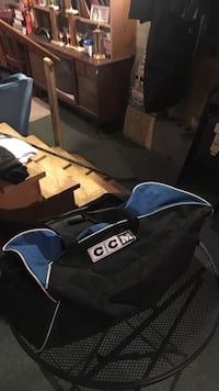 Black and blue ccm duffel bag