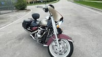 black and maroon touring motorcycle Kissimmee, 34741