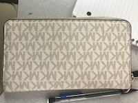 White and gray michael kors leather wristlet Cleveland, 44103