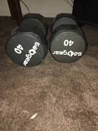 pair of 40 black fixed-weight dumbbells
