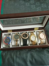Assorted analog watches in box